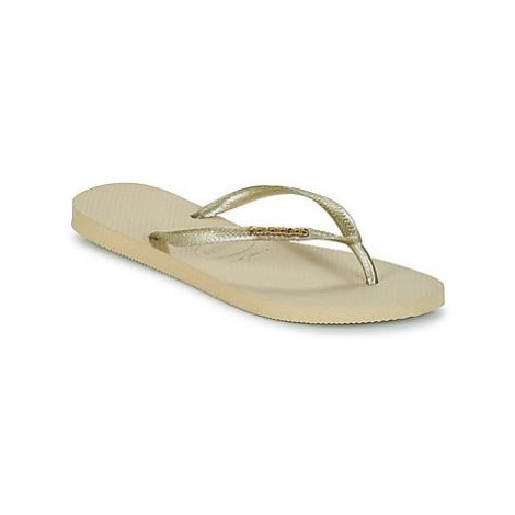 Havaianas SLIM LOGO METALLIC women's Flip flops / Sandals (Shoes) in Gold