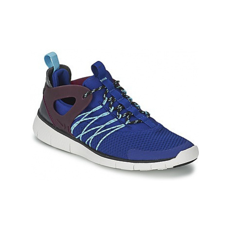 Nike FREE VIRTUS women's Shoes (Trainers) in Blue