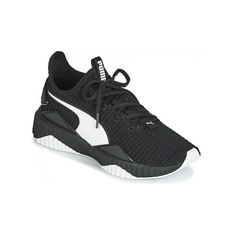 Puma WNS DEFY.BLK/WHT women's Shoes (Trainers) in Black