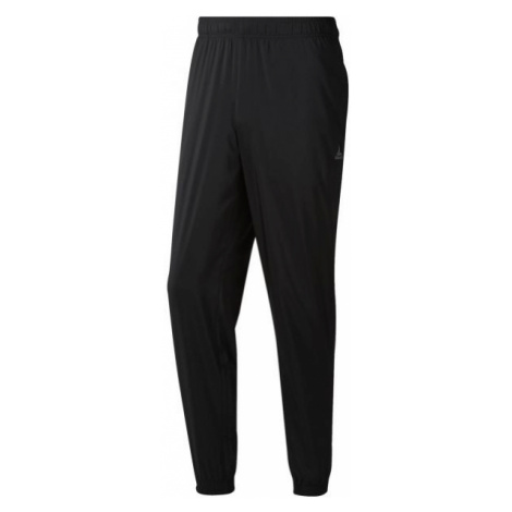 Reebok WOVEN CUFFED LINED PANT black - Men's sweatpants